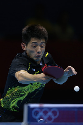 LONDON, ENGLAND - AUGUST 02:  Zhang Jike of China completes during Men's Singles Table Tennis Gold medal match against Wang Hao of China on Day 6 of the London 2012 Olympic Games at ExCeL on August 2, 2012 in London, England.  (Photo by Feng Li/Getty Imag
