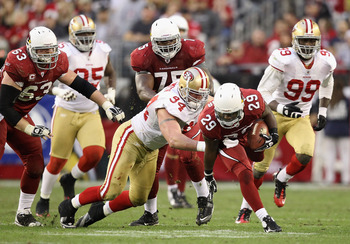 Justin Smith (No. 29) showing a helpless Chester Taylor how it's done.