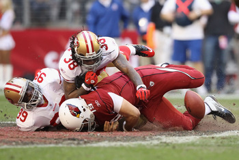 Aldon Smith (No. 99) and Dashon Goldson (No. 38) smashing QB John Skelton into the turf.