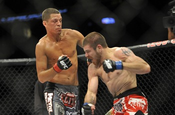 May 5, 2012; East Rutherford, NJ, USA;  Nate Diaz (left) and Jim Miller fight during their lightweight bout during UFC on Fox 3 at the Izod Center. Nate Diaz wins by submission in round two Mandatory Credit: Joe Camporeale-US PRESSWIRE