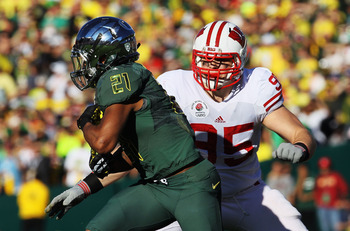 Former Wisconsin defensive lineman Patrick Butrym (95) is now chasing former Oregon back LaMichael James (21) in 49ers camp.