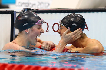 Franklin sharing the joy of a world record and gold medal with teammate Beisel.