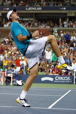 John Isner celebrates match point over Andy Roddick at the 2009 U.S. Open. Isner defeated Roddick in a fifth set tiebreaker.