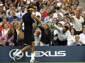Juan Martin Del Potro walks around Arthur Ashe Stadium after claiming the 2009 U.S. Open title.