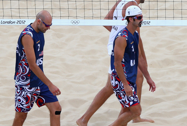 LONDON, ENGLAND - AUGUST 03:  Phil Dalhausser of the United States and Todd Rogers of the United States look dejected as they leave the court after the Men's Beach Volleyball Round of 16 match between United States and Italy on Day 7 of the London 2012 Ol
