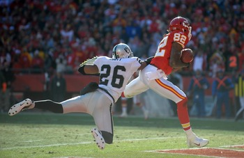 Dec 24, 2011; Kansas City, MO, USA; Kansas City Chiefs receiver Dwayne Bowe (82) is defended by Oakland Raiders cornerback Stanford Routt (26) at Arrowhead Stadium. The Raiders defeated the Chiefs 16-13 in overtime. Mandatory Credit: Kirby Lee/Image of Sp