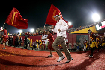 LOS ANGELES, CA - NOVEMBER 26:  Head coach Lane Kiffin leads the USC Trojans out of the tunnel for the start of the game against the UCLA Bruins at the Los Angeles Memorial Coliseum on November 26, 2011 in Los Angeles, California.  (Photo by Stephen Dunn/