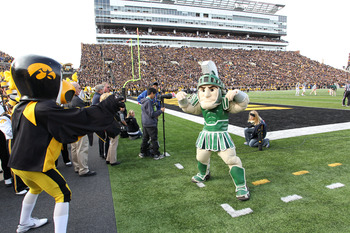 IOWA CITY, IA - NOVEMBER 12:  Herky the mascot of the Iowa Hawkeyes battles with Sparty of the Michigan State Spartans before kickoff at Kinnick Stadium November 12, 2011 in Iowa City, Iowa. Michigan State beat Iowa 37-21.  (Photo by Reese Strickland/Gett