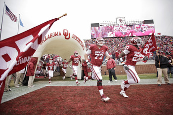 NORMAN, OK - NOVEMBER 26:  Members of the Oklahoma Sooners take the field before the game against the Iowa State Cyclones on October 26, 2011 at Gaylord Family-Oklahoma Memorial Stadium in Norman, Oklahoma. Oklahoma defeated Iowa State 26-6. (Photo by Bre
