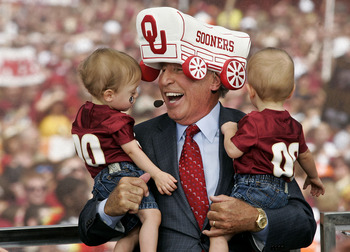 Sep 17, 2011; Tallahassee, FL, USA;  Wearing an Oklahoma Sooners hat, ESPN's College GameDay football analyst Lee Corso reacts to his grandsons, who are wearing Florida State shirts, prior to the start of the Florida State Seminoles college football game