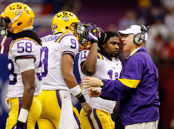 NEW ORLEANS, LA - JANUARY 09:  Head coach Les Miles of the Louisiana State University Tigers talks with Jordan Jefferson #9 on from the sidelines against the Alabama Crimson Tide during the 2012 Allstate BCS National Championship Game at Mercedes-Benz Sup