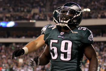 PHILADELPHIA, PA - NOVEMBER 07:  Brian Rolle #59 of the Philadelphia Eagles celebrates scoring a touchdown against the Chicago Bears during the second quarter of the game at Lincoln Financial Field on November 7, 2011 in Philadelphia, Pennsylvania.  (Phot