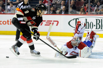 Carey Price making a save on Ottawa Senator Milan Michalek.
