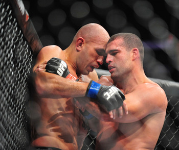 August 4, 2012; Los Angeles, CA, USA; Shogun Rua pins Brandon Vera in the head during the light heavyweight match at Staples Center. Mandatory Credit: Gary A. Vasquez-US PRESSWIRE