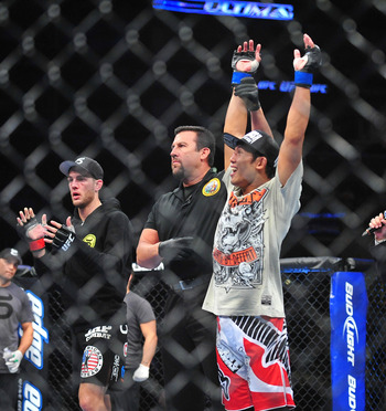 August 4, 2012; Los Angeles, CA, USA; Nam Phan celebrates after defeating Cole Miller during the featherweight match at Staples Center. Mandatory Credit: Gary A. Vasquez-US PRESSWIRE