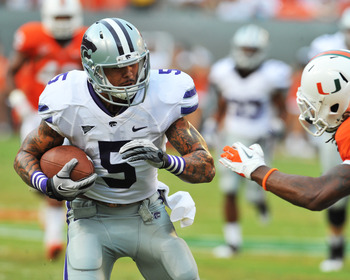 MIAMI GARDENS, FL - SEPTEMBER 24:  Wide receiver Brodrick Smith #5 of the Kansas State University Wildcats rushes upfield with a pass against the Miami Hurricanes September 24, 2011 at Sun Life Stadium in Miami Gardens, Florida.  (Photo by Al Messerschmid