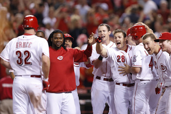 CINCINNATI, OH - AUGUST 14: Jay Bruce #32 of the Cincinnati Reds celebrates with teammates after hitting a three-run home run in the ninth inning of the game against the New York Mets at Great American Ball Park on August 14, 2012 in Cincinnati, Ohio. The