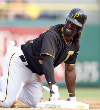 PITTSBURGH, PA - AUGUST 16:  Andrew McCutchen #22 of the Pittsburgh Pirates has a laugh while on base against the Los Angeles Dodgers during the game on August 16, 2012 at PNC Park in Pittsburgh, Pennsylvania.  (Photo by Justin K. Aller/Getty Images)