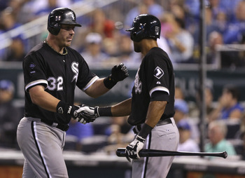 KANSAS CITY, MO - AUGUST 18: Adam Dunn #32 of the Chicago White Sox celebrates his two-run home run with Alex Rios #51 during a game against against the Kansas City Royals in the eighth inning at Kauffman Stadium on August 18, 2012 in Kansas City, Missour
