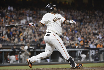 SAN FRANCISCO, CA - AUGUST 14:  Pablo Sandoval #48 of the San Francisco Giants swings and watches the flight of his ball as he hits a sacrifice fly driving in Melky Cabrera #53 (not pictured) in the eighth inning against the Washington Nationals at AT&T P