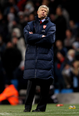 MANCHESTER, ENGLAND - DECEMBER 18:  Arsenal Manager Arsene Wenger reacts during the Barclays Premier League match between Manchester City and Arsenal at the Etihad Stadium on December 18, 2011 in Manchester, England.  (Photo by Alex Livesey/Getty Images)