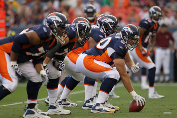 DENVER - AUGUST 29:  Center J.D. Walton #50 of the Denver Broncos leads the offensive line as he  prepares snap the ball against the Pittsburgh Steelers during preseason NFL action at INVESCO Field at Mile High on August 29, 2010 in Denver, Colorado. The