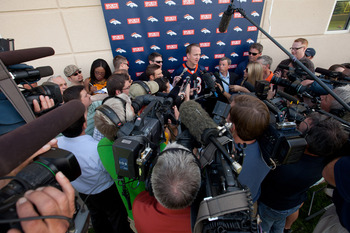 ENGLEWOOD, CO - MAY 21:  Quarterback Peyton Manning #18 of the Denver Broncos talks to the local and national media following organized team activities at Dove Valley on May 21, 2012 in Englewood, Colorado. (Photo by Justin Edmonds/Getty Images)