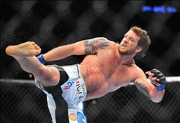 August 4, 2012; Los Angeles, CA, USA; Ryan Bader kicks Lyoto Machida during the light heavyweight match at Staples Center. Mandatory Credit: Gary A. Vasquez-US PRESSWIRE