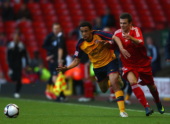 LIVERPOOL, ENGLAND - MAY 26:  Alexander Kacaniklic of Liverpool battles with Francis Coquelin of Arsenal during the second leg of the FA Youth Cup final sponsored by E.ON, between Liverpool and Arsenal at Anfield on May 26, 2009 in Liverpool, England.  (P