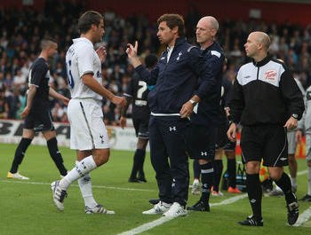 STEVENAGE, ENGLAND - JULY 18:  Tottenham Hotspur manager Andre Villas Boas talks to David Bentley during the Pre Season Friendly match between Stevenage and Tottenham Hotspur at The Lamex Stadium on July 18, 2012 in Stevenage, England.  (Photo by Pete Nor