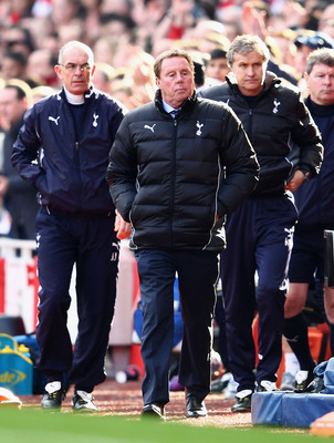 Redknapp (centre) and his coaching staff leave the technical area at the Emirates Stadium dejected as his Tottenham side suffers a humiliating 5-2 loss to rivals Arsenal.