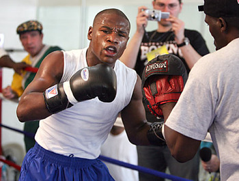 Mayweather with a pair of Winnings during training.