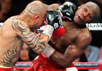 Miguel Cotto wearing Everlasts against Floyd Mayweather.