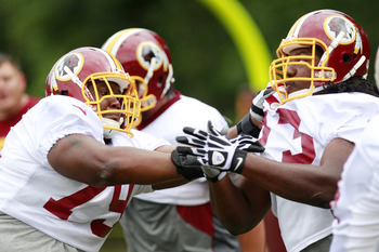 July 27, 2012; Ashburn, VA, USA; Washington Redskins offensive guard Maurice Hurt (79) and guard Adam Gettis (73) participate in drills during Redskins training camp at Redskins Park. Mandatory Credit: Geoff Burke-US PRESSWIRE