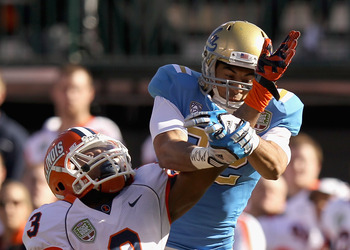 SAN FRANCISCO, CA - DECEMBER 31: Tavon Wilson #3 of the Illinois Fighting Illini breaks up a pass intended for Taylor Embree #82 of the UCLA Bruins during the Kraft Fight Hunger Bowl at AT&T Park on December 31, 2011 in San Francisco, California.  (Photo