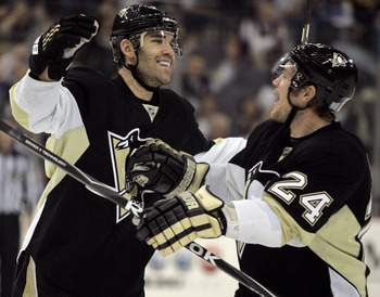 Pascal Dupuis (right) and Matt Cooke (left) celebrate a goal.