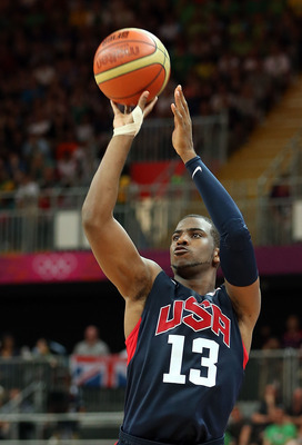 LONDON, ENGLAND - AUGUST 04:  Chris Paul #13 of United States puts up a shot against Lithuania during the Men's Basketball Preliminary Round match on Day 8 of the London 2012 Olympic Games at the Basketball Arena on August 4, 2012 in London, England.  (Ph