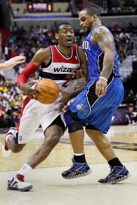 WASHINGTON, DC - FEBRUARY 29: John Wall #2 of the Washington Wizards draws a foul while being guarded by Jameer Nelson #14 of the Orlando Magic during the second half at the Verizon Center on February 29, 2012 in Washington, DC. NOTE TO USER: User express