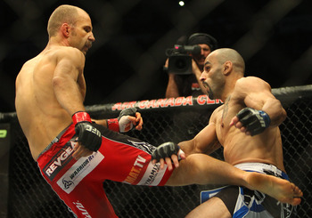Dec 10, 2011; Toronto, ON, Canada; UFC fighter Jared Hamman (left) against fighter Costa Philippou (right) during a middleweight bout at UFC 140 at the Air Canada Centre. Mandatory Credit: Tom Szczerbowski-US PRESSWIRE