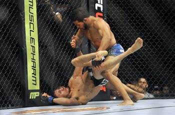 May 5, 2012; East Rutherford, NJ, USA;  Dennis Bermudez (top) fights Pablo Garza in a featherweight bout during UFC on Fox 3 at the Izod Center. Dennis Bermudez won by unanimous decision in third round. Mandatory Credit: Joe Camporeale-US PRESSWIRE