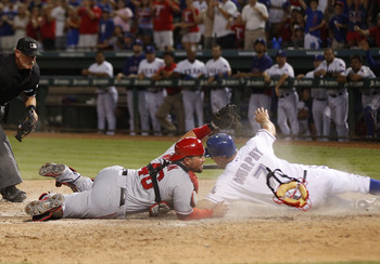 ARLINGTON, TX - AUGUST 2:  David Murphy #7 of the Texas Rangers is tagged out by Bobby Wilson #46 of the Los Angeles Angels of Anaheim at Rangers Ballpark in Arlington on August 2, 2012 in Arlington, Texas.  (Photo by Rick Yeatts/Getty Images)