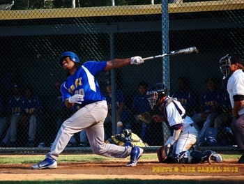 Shaq Thompson in an apparent struggle at the plate during a Grant Union High School game in Sacramento, Calif.