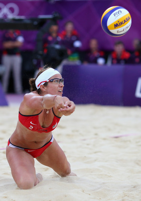 LONDON, ENGLAND - AUGUST 07:  Misty May-Treanor of the United States sets the ball the Women's Beach Volleyball Semi Final match between United States and China on Day 11 of the London 2012 Olympic Games at Horse Guards Parade August 7, 2012 in London, En