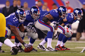 EAST RUTHERFORD, NJ - DECEMBER 04:  Offensive linemen center Kevin Boothe #77, guard Mitch Petrus #62, tackle David Diehl #66 and tight end Jake Ballard #85 of the New York Giants line up in their stance against the Green Bay Packers at MetLife Stadium on