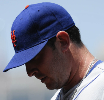 SAN DIEGO, CA - AUGUST 5:  Matt Harvey #33 of the New York Mets walks off the field at the end of the third inning of a baseball game against the San Diego Padres at Petco Park on August 5, 2012 in San Diego, California. (Photo by Denis Poroy/Getty Images