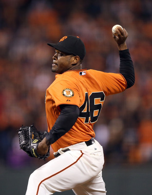 SAN FRANCISCO, CA - JULY 13:  Santiago Casilla #46 of the San Francisco Giants pitches against the Houston Astros at AT&T Park on July 13, 2012 in San Francisco, California.  (Photo by Ezra Shaw/Getty Images)