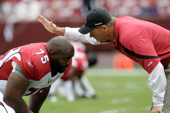 It's been an early struggle for the Cardinals' offensive line and and left tackle Levi Brown (75)