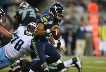 Seahawks' quarterback Russell Wilson threw for one touchdown and ran for another against the Titans