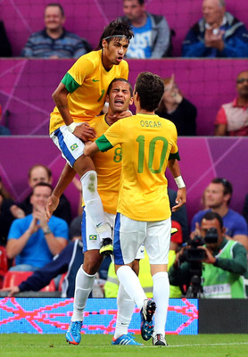 MANCHESTER, ENGLAND - AUGUST 07: Romulo (C) of Brazil celebrates with Neymar and Oscar after scoring during the Men's Football Semi Final match between Korea and Brazil, on Day 11 of the London 2012 Olympic Games at Old Trafford on August 7, 2012 in Manch