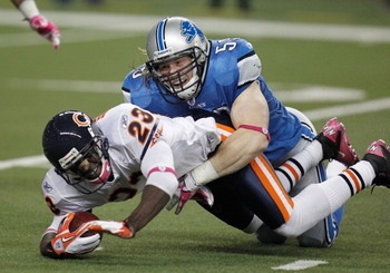 DETROIT, MI - OCTOBER 10:  Bobby Carpenter #59 of the Detroit Lions makes a tackle during a punt return on Devin Hester #23 of the Chicago Bears at Ford Field on October 10, 2011 in Detroit, Michigan.  (Photo by Gregory Shamus/Getty Images)